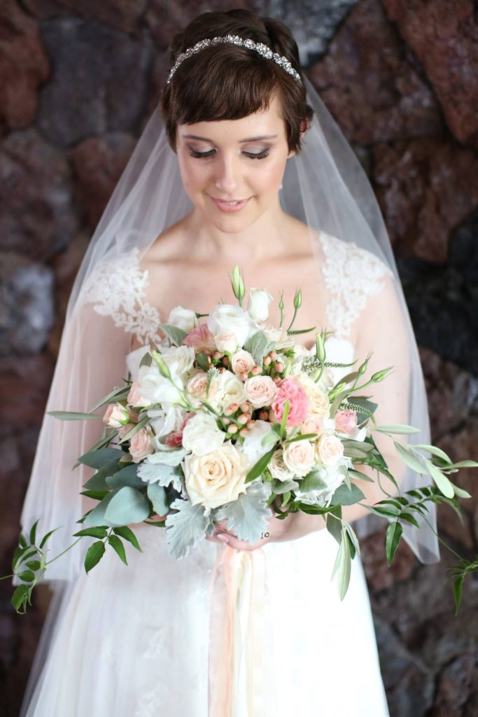 Whimsical white and peach wedding bouquet